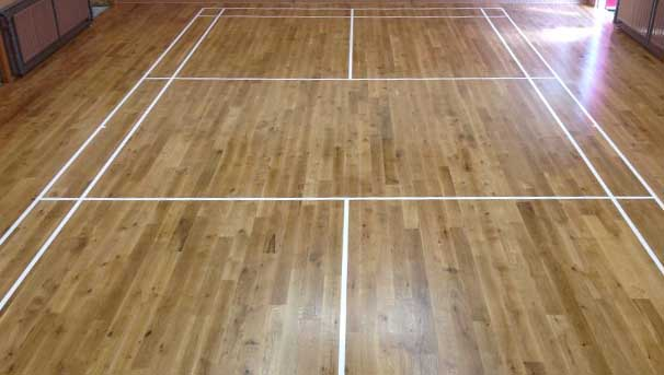 Absolute Floorcare sand and seal wooden floors and redo sports courts markings